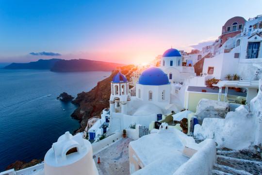 Sunset over Greek buildings