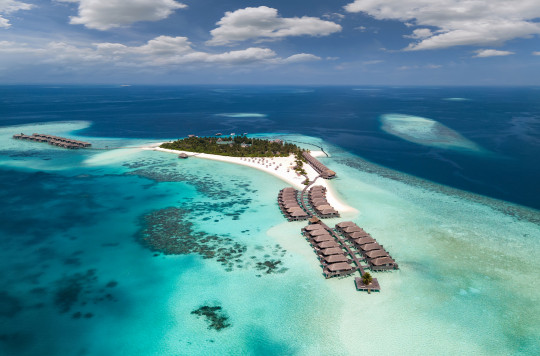 Aerial shot of huts in the sea in the Maldives