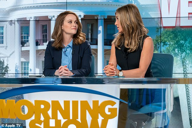 Competitors: After Steve Carell's anchor is fired for sexual misconduct Aniston's co-host Alex Levy fights to keep her job, while field reporter Bradley Jackson (Witherspoon) joins the show as a new anchor; still from The Morning Show