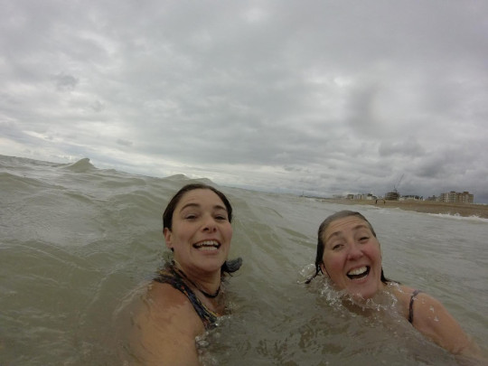 Tracey in the sea with a fellow swimmer