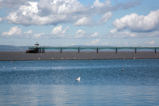 Marine Lake tidal pool in Clevedon with Clevedon pier in the background, Somerset England UK