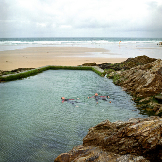 2 young women float in Chapel Rock Pool, Perranporth, Cornwall, UK. Until the 1950s and the rise of the heated indoor swimming pool, children learnt to swim outdoors. For those close to the sea, many man-made tidal swimming pools were constructed around Britain's coastline. Heated by the sun, these tidal pools were often built to keep bathers safe from high and rough seas, which explains why so many of them are clustered in Scotland and around the surfing beaches of Cornwall. Whether they are si (Photo by In Pictures Ltd./Corbis via Getty Images)