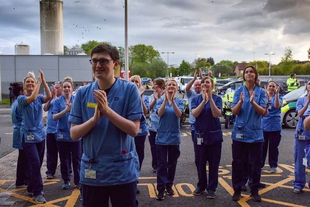 NHS staff clap for carers at Queen Elizabeth Hospital in Glasgow during the first wave