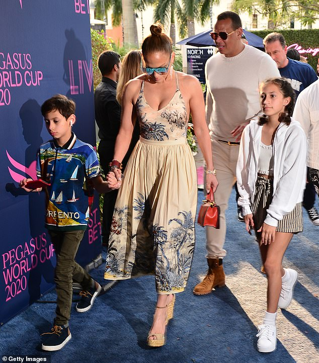 Family:The two have been living together for the past four years as they co-parent her twins Max and Emme and his daughters Natasha and Ella from a previous relationship (pictured with her children Max and Emme in 2020)