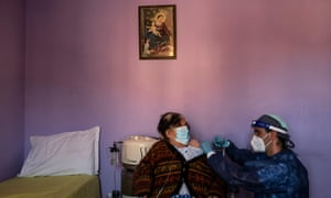 A medical worker injects an over 80-years-old woman with a dose of Moderna vaccine against Covid-19 at her home in Dronero, Maira Valley, near Cuneo, Northwestern Italy.