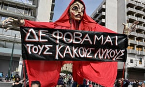 "Greek puppet theatre artists march with a giant puppet bearing the slogan ""I m not afraid of bad wolves"" during a demonstration of artists against the restrictions and the government's policies to deal with the ongoing Covid-19 pandemic in Athens on March 13, 2021."