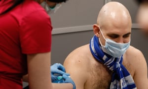 Zenit supporter receives a dose of the Sputnik V vaccine against COVID-19 at newly opened vaccination center operating at the stadium ahead of the Russian Premier League match between FC Zenit Saint Petersburg and FC Akhmat Grozny