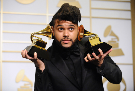 The Weeknd with awards at The 58th GRAMMY Awards