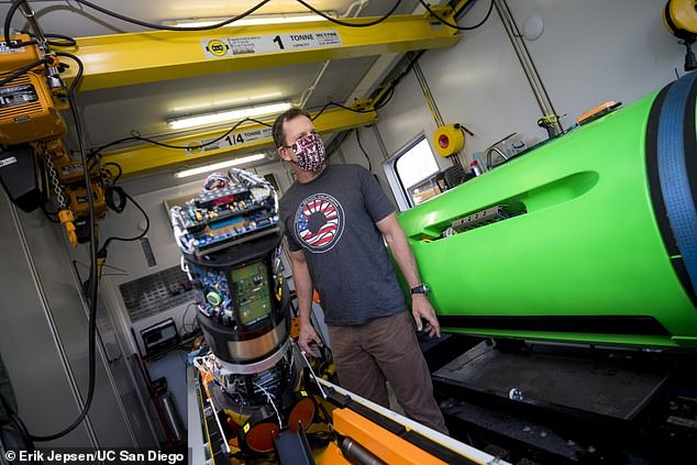 Pictured: Marine researcher Eric Terrill prepares Remote Environmental Monitoring UnitS (REMUS). The robot subs come equipped with sonar tech that collects data from the ocean floor