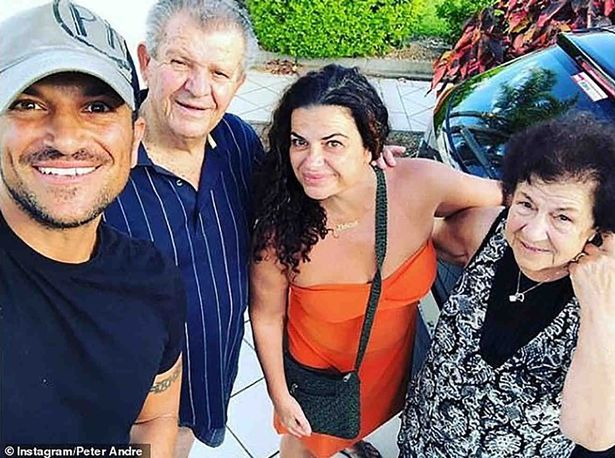 Peter Andre with his parents and sister