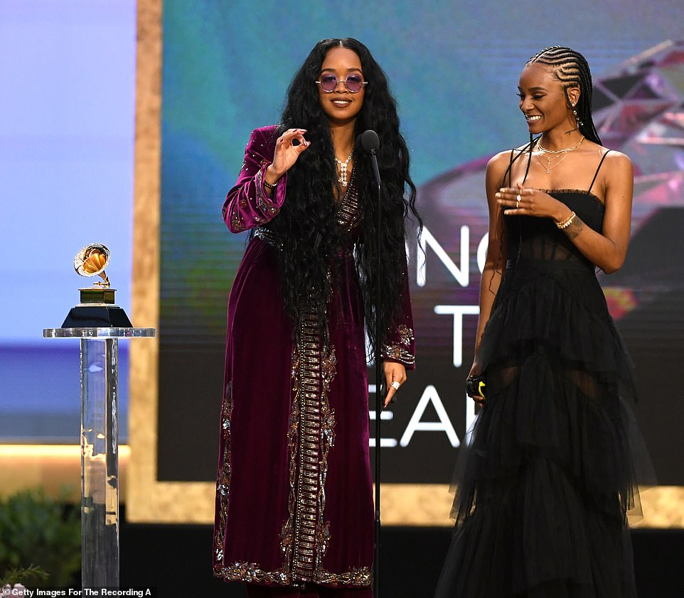 Earned it:H.E.R. scored one of the biggest upsets of the night as she beat out competition including Beyonce and Jay-Z in the Song Of The Year category as she was joined by Tiara Thomas who was featured on the song