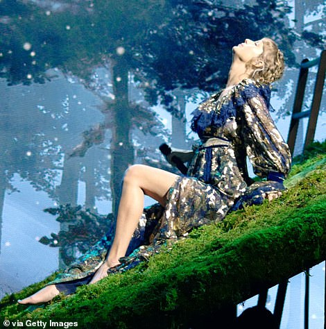Stunning: Taylor sat on the roof of the home which included greenery atop it
