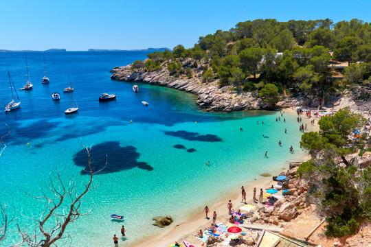 People enjoying vacations in the Cala Salada lagoon. Idyllic scenery. Ibiza, Balearic Islands. Spain