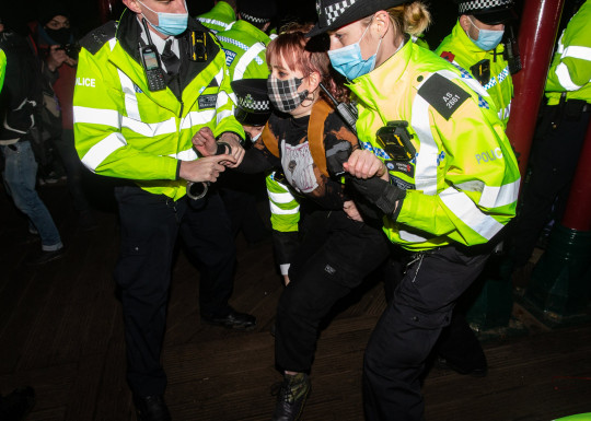 Woman being detained by police at Sarah Everard vigil at Clapham Common