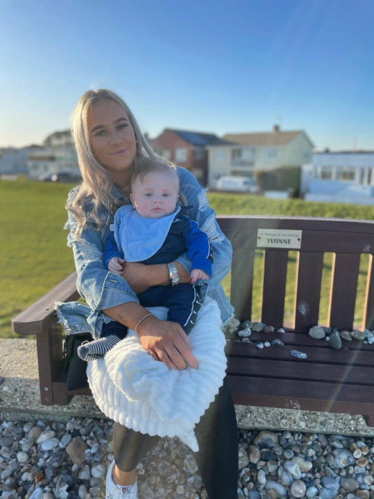 **Sent under embargo no use before 14.00 GMT March 5 2021** Tia Walters with baby Roman Tomlinson. See SWNS story SWFTbaby. A mum whose baby bump was so big people thought she was having twins gave birth to a baby as a big - as a bowling ball. Size-six Tia Walters, 19, was so large during pregnancy she struggled to get up off the sofa. She found out why when she gave birth to Roman Tomlinson, on 23rd October 2020, who tipped the scales at a whopping 10lbs 8oz. Tia's bump had grown so big people kept asking if she was having twins.