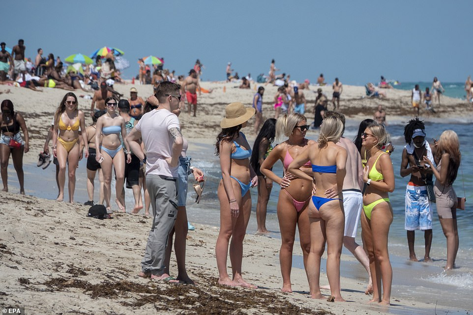 Maskless spring breakers crowded the waterfront in South Beach, Florida, where Governor Ron DeSantis has dropped fines for people who don't wear masks or follow other restrictions. CDC Director Dr Rochelle Walensky warned that this fueled a surge in in cases last spring and will again this year, if people don't follow precautions