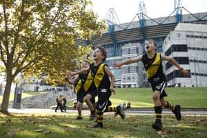 Fans kick the footy outside the MCG.
