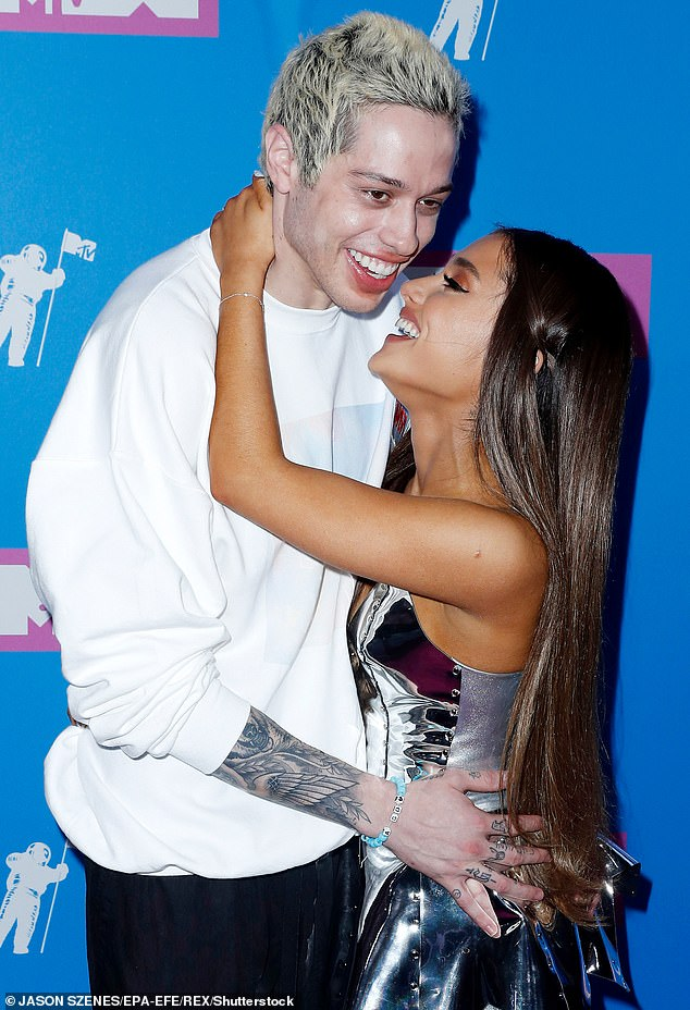 Romantic history: His love life has frequently draw attention, sharing flings with the likes of Margaret Qualley, 26, Kaia Gerber, 19, and Kate Beckinsale, 47, as well as a whirlwind engagement to Ariana Grande, 27 (pictured with Grande in August, 2018)