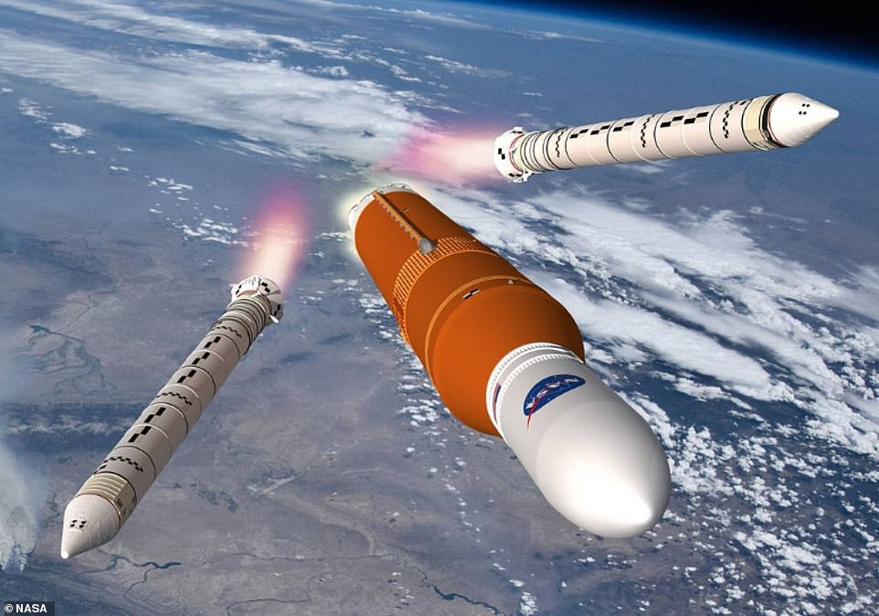The Space Launch System (SLS) 'megarocket' that will one day take astronauts to the moon and Mars has passed a major assembly milestone, according to NASA. This is an artist's impression of the rocket as it will appear in space discarding its boosters