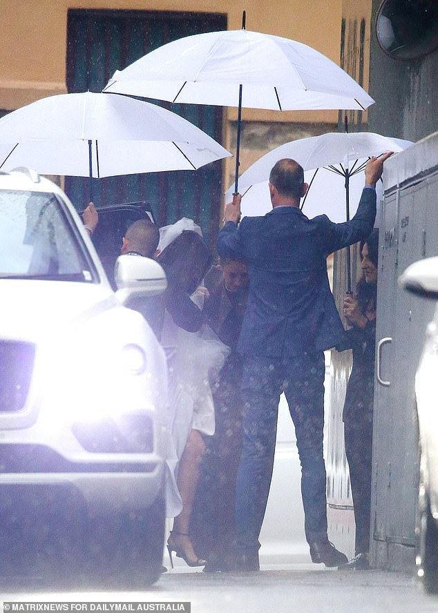Can't rain on their parade! The happy couple managed to puff off the lavish affair despite the unfortunate weather