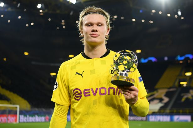 Erling Haaland of Borussia Dortmund poses for a photo with the UEFA Champions League Player of the Match award after the UEFA Champions League Round of 16 match between Borussia Dortmund and Sevilla FC at Signal Iduna Park on March 09, 2021 in Dortmund, Germany.