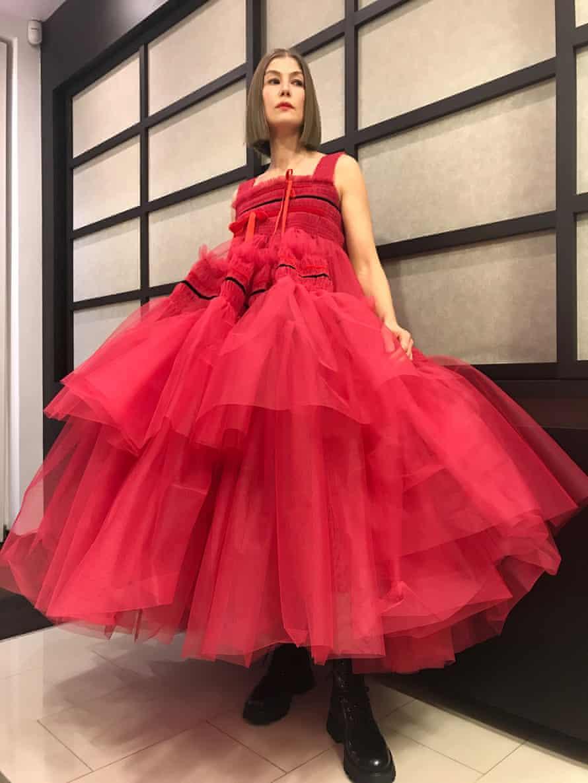 Rosamund Pike in a big red flouncy Molly Goddard dress