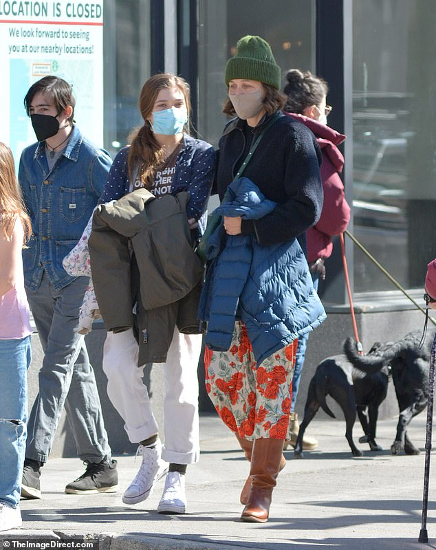 The un-glam glam look:u00A0The star appeared to be makeup free as she wore a nude colored face mask with her brown hair down. Maggie wore several layers and carried a down jacket while wearing a cross body purse