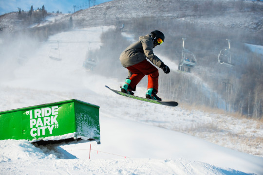 Snowboard jumps on the slopes of Park City Mountain Resort.