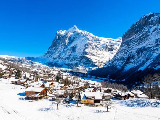 Winter landscape in Grindelwald at sunrise, behind the Mittelhorn and Wetterhorn, Wetterhorn, Interlaken-Oberhasli, Bernese Oberland, Canton of Bern, Switzerland