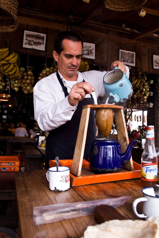 B9WPAH Man making coffee with traditional chorreador in a restaurant in San Jose, Costa Rica.