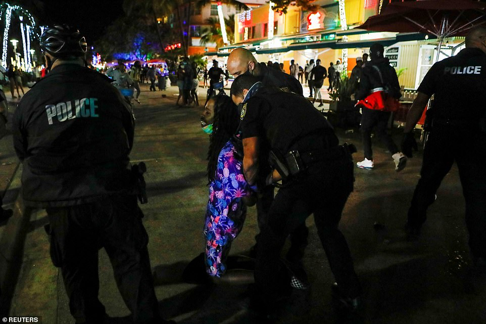 Police officers have arrested at least 1,000 people in South Beach and SWAT teams have been called in to use pepper balls to break up crowds of partiers