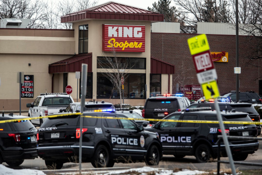 Police respond at a King Sooper's grocery store where a gunman opened fire.