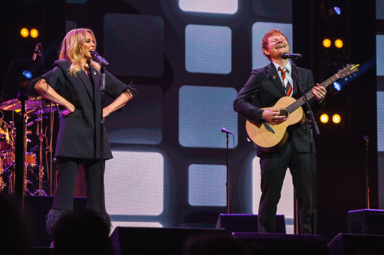 A supplied image of a Kylie Minogue and Ed Sheeran performing during a state memorial for Michael Gudinski at Rod Laver Arena, in Melbourne, Wednesday, March 24, 2021. The life of Australian music industry great Michael Gudinski will be commemorated in a state memorial at Melbourne's Rod Laver Arena. (AAP Image/Supplied by Mushroom Creative House) NO ARCHIVING, EDITORIAL USE ONLY