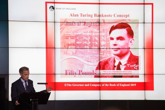 Mark Carney, governor of the Bank of England, revealing the new £50 note face.