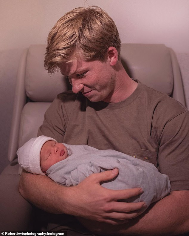 'Let the uncle adventures begin!' Meanwhile, Robert took to his Instagram to share a photo of himself cradling his niece. In the photo, he looked down adoringly at his sister's bundle of joy as she slept peacefully in his arms
