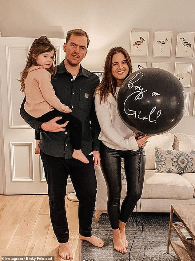 'It's nice to see': The MIC star, 30, said she's given hope to fellow sufferers now she's expecting a child with fiancé Max Darnton, 31 (pictured together with daughter India, three)