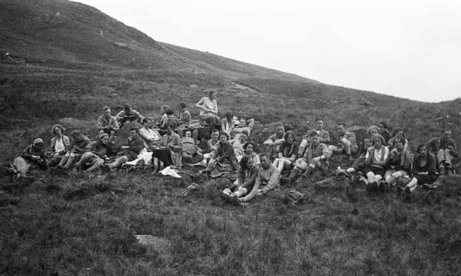 Ramblers resting on Kinder Scout hills in Derbyshire 1932