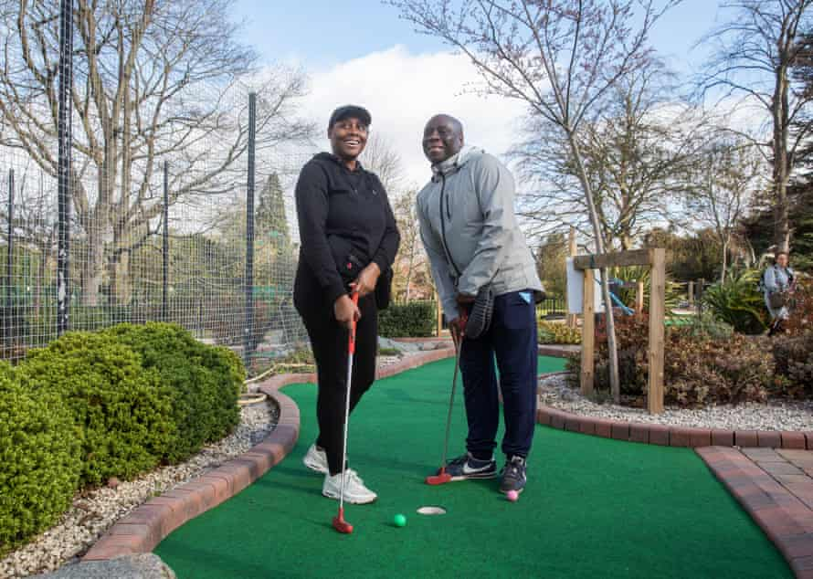 Father and daughter Carl and Shola Easy of Birmingham having a game of crazy golf in Cannon Hill Park