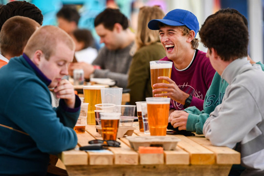 people drinking in a beer garden in glasgow