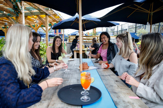 Customers at Skylight Rooftop bar enjoy a drink together on July 4, 2020 in London, United Kingdom.