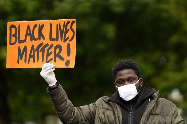 A man holds a Black Lives Matter placard as people demonstrate during a peaceful protest in Middlesbrough town centre last year