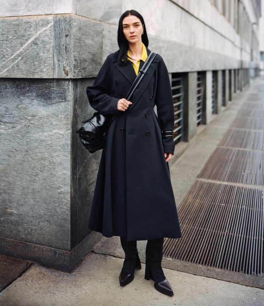 An image of a model on a street corner in Bottega Veneta Issue 01