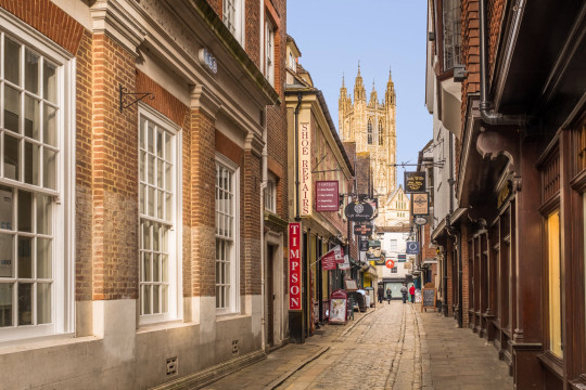 A view of Canterbury Cathedral at the bottom of the cobbled Butchery Lane.