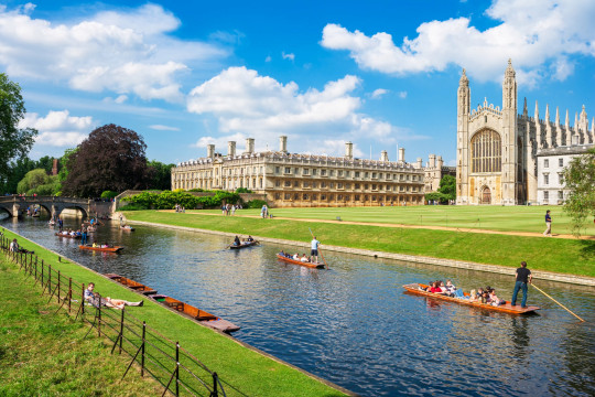 Tourists on punt trip (sightseeing with boat) along River Cam near Kings College in the city of Cambridge, England