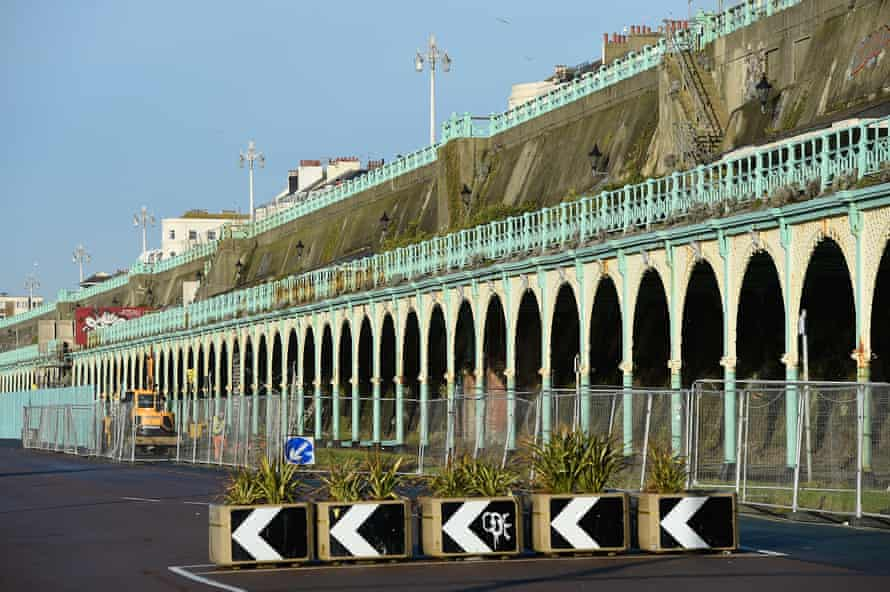 The dilapidated Madeira Terrace on Brighton seafront lies fenced off