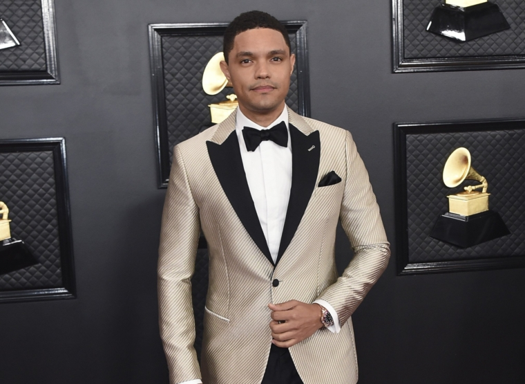 FILE - Trevor Noah arrives at the 62nd annual Grammy Awards in Los Angeles on Jan. 26, 2020. Noah will host the 2021 Grammy Awards on Sunday. (Photo by Jordan Strauss/Invision/AP, File)