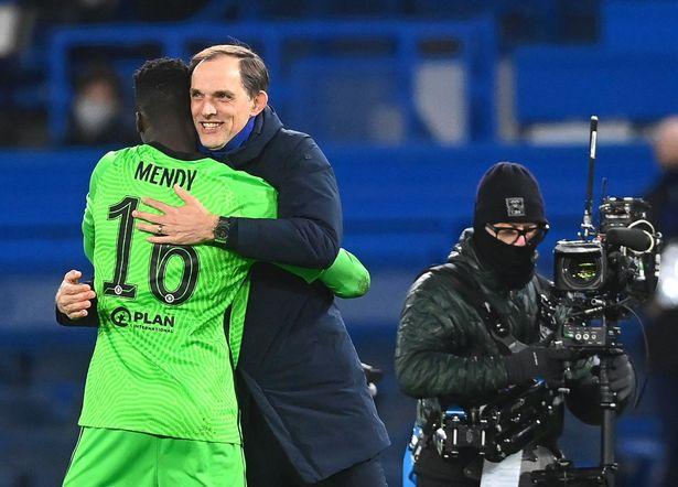 Chelsea's manager Thomas Tuchel (C) celebrates with goalkeeper Edouard Mendy