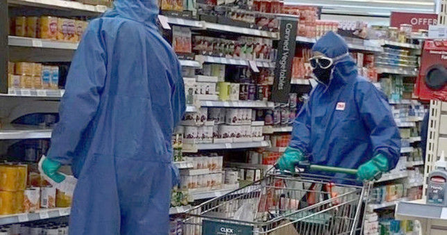 These two shoppers wore hazmat suits to go to Waitrose