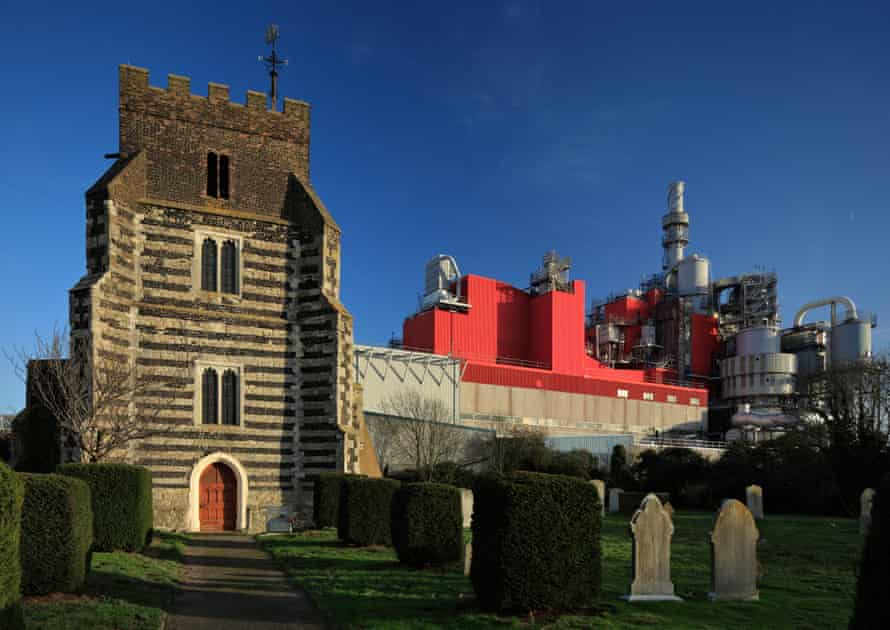 St Clement's church in West Thurrock, with the Procter & Gamble factory behind it.