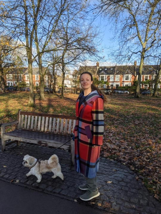Kate Leaver walking her shih tzu Bert in the park on a winter's day